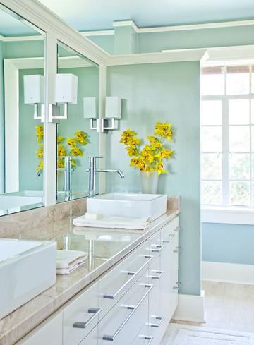 Lighter Shades Of Turquoise Paired With White Bathroom Vanities And Lots Of Natural Light Have a Breezy, Open-Air Feel