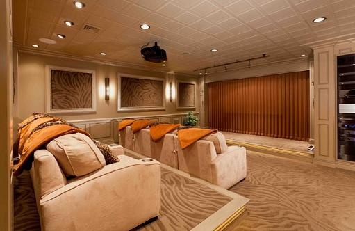 Basement Home Theater With Surround Sound, Acoustic Panels, And Two Tier Seating (by Custer Design Group)