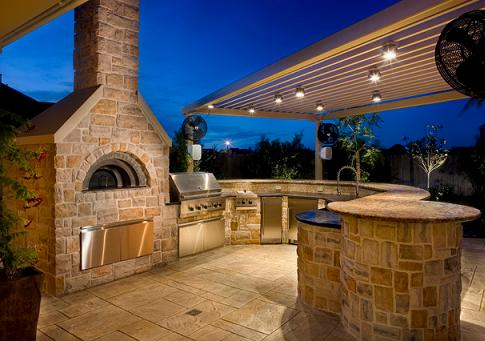 Outdoor Kitchen With Grill And Woodfire Pizza Oven (by Frankel Building Group, photo by Michael Hart)
