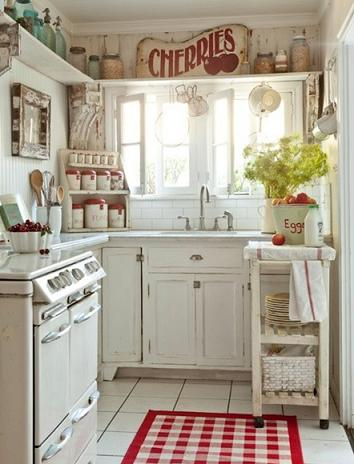 Distressed White Cabinets Paired With Rougn And Tumble Antique Accessories Creates An Incredibly Homey, Old Fashioned Farmhouse Kitchen (by Sunday Henrickson from tumbleweed and dandelion.com, photo)