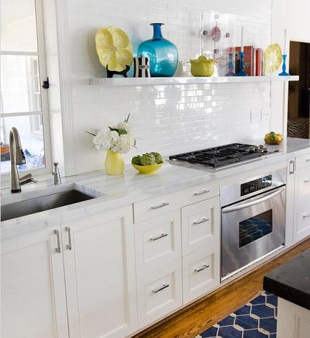 These Gorgeous White Marble Cuonter Tops And Elegant Subway Tile Are Brought To Life By A Shelf Filled With Colorful Accents (by Charles Luck Stone Center)