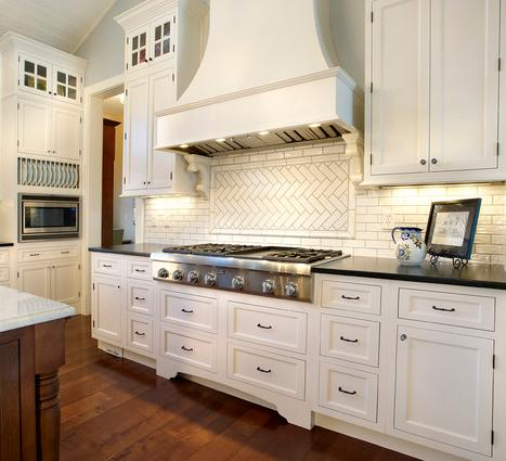White Kitchen With Traditional And Herringbone Subway Tile And LaFontaine Style Cabinet Fronts (By Kristin Petro Interiors Inc.)