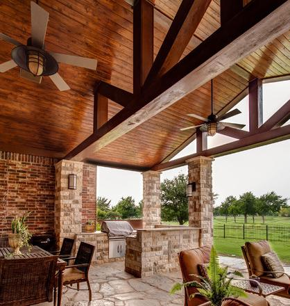 Outdoor Kitchen With Ceiling Fans (by 708 Studios LLC, photo by Lisa Piper)