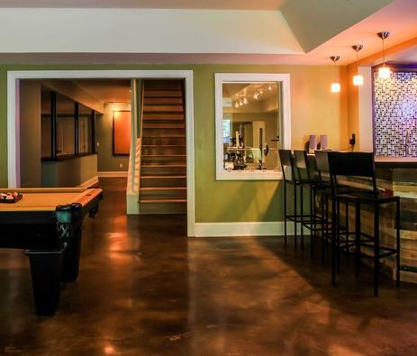 This Stained Concrete Floor Makes Cleanup A Breeze In This Large Finished Basement (by Daniel M. Martin)