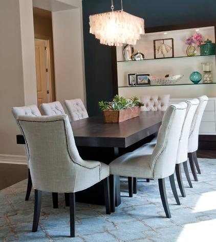 Classic Nailhead Upholstered Chair Bodies With Simple Modern Legs Create An Upscale Contemporary Look And Feel (by Red Egg Design Group, photo by Courtney Lively)