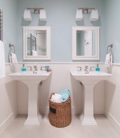 White Porcelain Pedestal Sinks Are Easy To Maintain And Add A Bright, Clean Quality To The Bathroom (by RemodelWest)