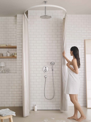 Barrier-free showers make for a totally uninterrupted bathroom that looks and feels much larger
