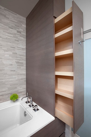 Custom built storage will make any size bathroom more usable, while the right lighting will make it feel brighter and more open and inviting (by Best Builders ltd, photo by Ema Peters)