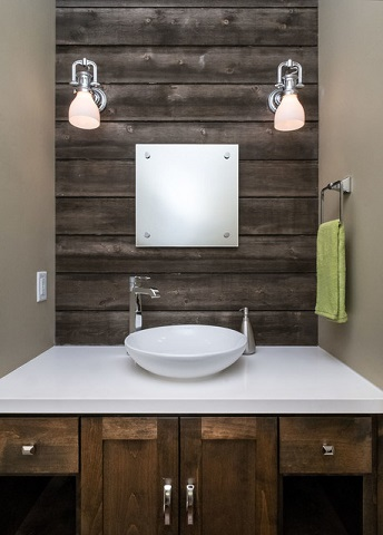A little bit of reclaimed wood - even in a very dark shade - looks great, but be sure to balance it out with lots of light neutrals and natural light from feeling closed or oppressive