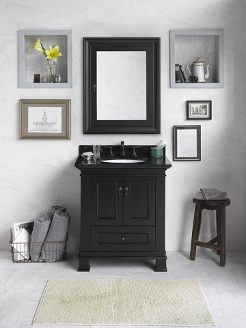 Adding just a touch of black to a white on white cottage style bathroom will make the whole space look more striking and modern, no bold patterns or wild designs needed