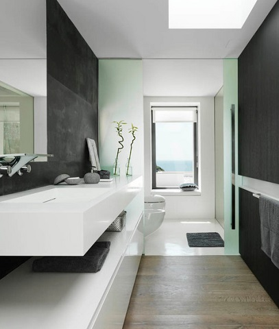Asian inspired bathrooms can be very modern while still retaining that natural elegance and simplicity, provided you include a few earthy elements to draw the eye (by Susanna Cots, photo by Mauricio Fuertes)