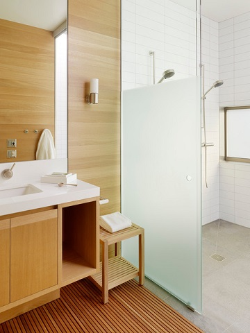 Bamboo wood elements give a bathroom a warm, bright quality while offering a greater degree of water resistance than most hardwoods (by CCS Architecture, photo by Joe Fletcher)