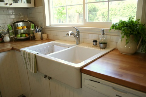 Butcher block style wood countertops add a warm, natural quality to any kitchen, and are really meant to be used (by The Old Painted Cottage)