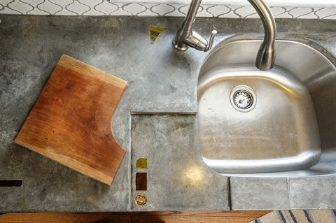 Concrete countertops can be poured in house and custom shaped and tinted, but require some special care (by Craftwork)