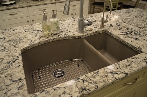 Engineered quartz countertops can mimic the appearance of marble or granite, but are much more durable and lower maintenance, and have a more consistent appearance (by Studio 76 Kitchens and Baths)