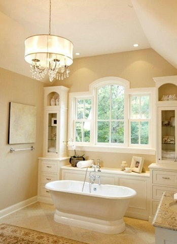 Even a simple cottage style bathroom gains a distinctly more sophisticated, elegant appearance with the addition of a crystal chandelier (by Stonewood LLC)