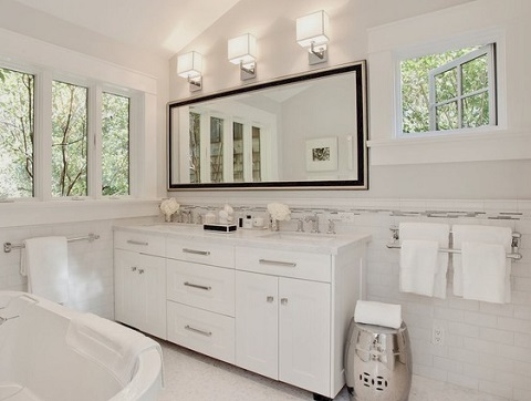Installing fresh, contemporary cabinet hardware is one of the few ways to update a bathroom vanity cabinet without replacing it (Urrutia Design, photo by Jason Wells)