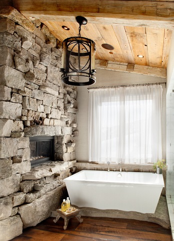 Pairing reclaimed wood with stacked, unfinished stone is a great way to create a very earthy, natural twist on the classic cottage style bathroom