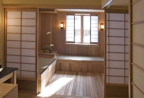 Sliding shoji style doors give a bathroom a dynamic quality, making it possible to open up the space or add privacy without barring natural light (by Orfield Remodeling, Inc)