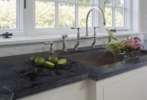 Soapstone counters have a gorgeous deep gray color and slightly more rustic texture that works perfectly with a farmhouse or cottage style kitchen (by Jewett Farms and Co, photo by Eric Roth)