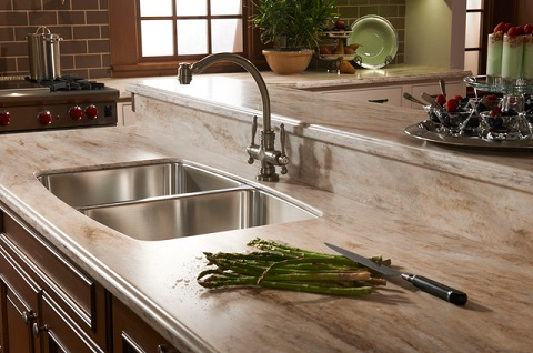 Solid surface countertops can mimic the appearance of stone without requiring the same intensive upkeep, but are also less durable (by Cabinet Innovations)