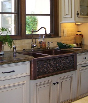 Switching from fireclay to copper takes apron sinks to the next level, offering a much more opulet, ornate appearance (by Design Moe Kitchen and Bath)