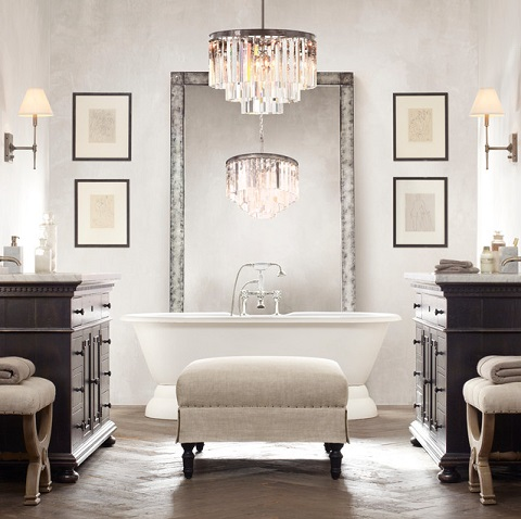 This year, pairing soft grays, canvas upholstery, and reclaimed wood is an especially popular way to combine an elegant, sophisticated look with a simpler, more rustic feel (by Restoration Hardware)