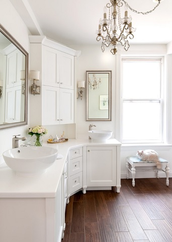Though it might seem silly, using a cottage style in a larger bathroom will immediately elevate the design, making it feel more open, elegant, and luxurious (by Claire Jefford at Creating Contrast Designs, photo by Buchman Photo)