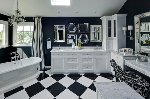 Vivid patterns done in a high contrast black and white completely alter the appearance of a cottage style bathroom, giving it a posh, modern look and fee (by Drury Design)