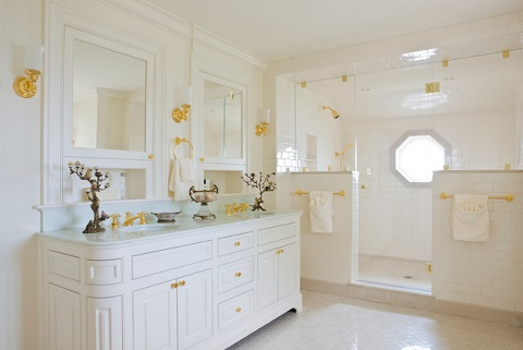 Gold is an especially eye-catching color, but this bathroom nicely demonstrates how having coordinated hardware and fixtures throughout the bathroom can help unify the space (by Elizabeth Brosnan Hourihan Interiors, photo by Gordon Beall)