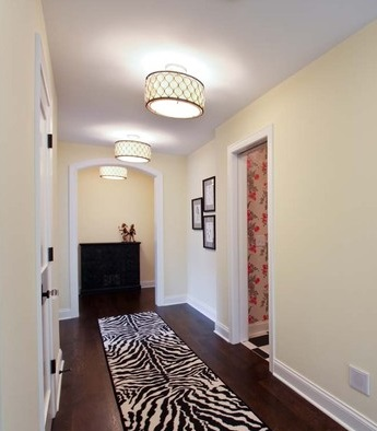 Flush mount lighting combines a compact profile with a decorative appearance that's great for dressing up a hallway with low ceilings (by REFINED LLC)