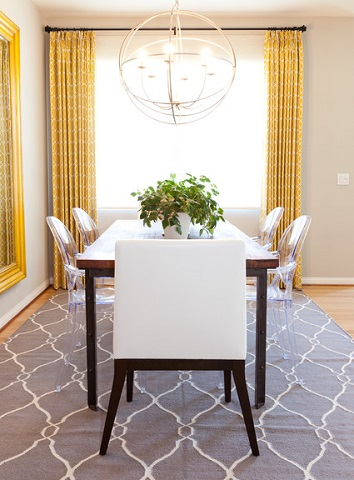 There's nothing worse than your chair leg catching on the edge of your dining table rug, so be sure to add a few extra inches in every direction to account for it (by Lilium Designs, photo by Dane Wirtzfeld)