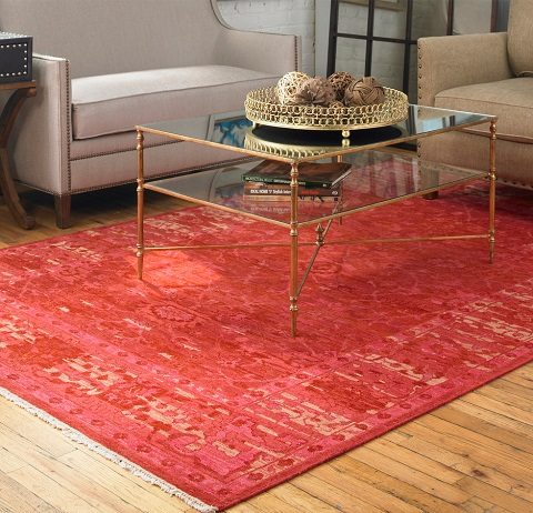 You can get away with centering a small, colorful or boldly patterned rug underneath your coffee table, but unless it will fit at least half way underneath your sofa, keep the other feet off it!