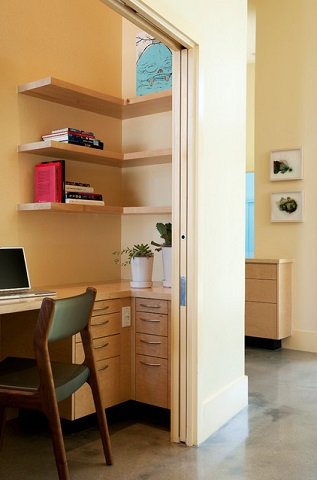 If you want to store your chair inside your cloffice, make sure to incorporate it into your initial designs to be sure it will fit with the closet door closed (by Studio 512, photo by Casey Woods)