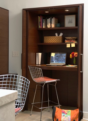 Pocket and foldaway doors tuck completely out of sight, opening the cloffice up to the rest of the room while it's in use (by Ingrained Wood Studios, photo by Susan Gilmore)