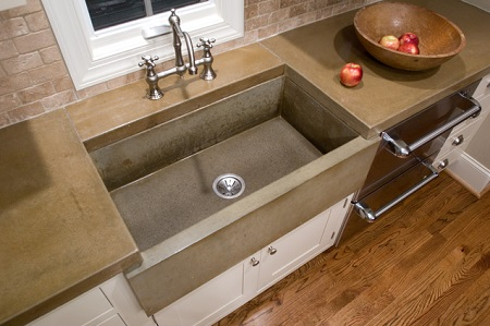 Concrete kitchen sinks are a striking modern feature that's gaining popularity with many homeowners (by Reaching Quiet Desigh, photo by Indigo Photography)