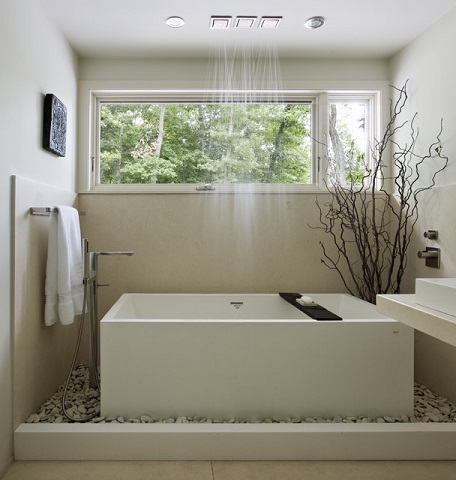 Having a little breathing room around your bathtub makes it possible to turn even a simple tub into something extraordinary (by Denali Construction)