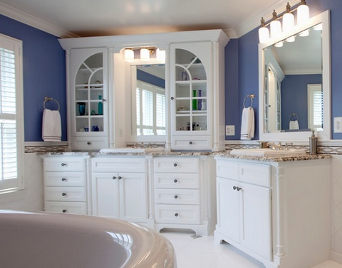 Custom cabinetry is an ideal option for very large or odd shaped master bathrooms, where you want a lot of cabinets and may need to accommodate unusual angles (by Case Design Remodeling, Inc.)