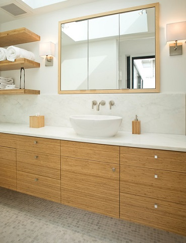 Blonde finished wood shelves are a perfect pair for a nordic inspired spa style bathroom (by Marla Schrank Interiors)