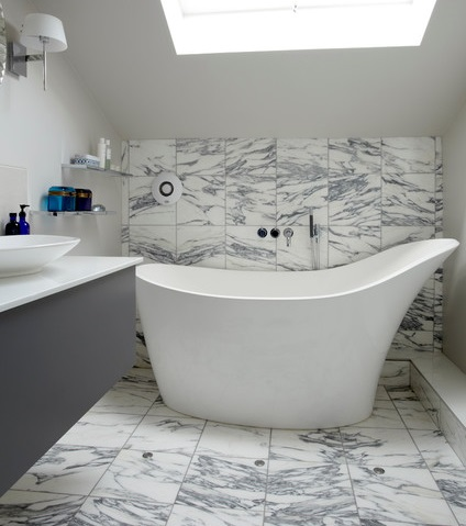Sculptural modern bathtubs can be elegant and luxurious while maintaining a smaller footprint than most luxury freestanding bathtubs (by Chantel Elshout Design Consultancy, photo by Rowland Roques-O'Neil)