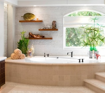 Simple reclaimed wood shelves can add a nice natural element to a bathroom, particularly when paired with live plants (by Arch-Interiors Design Group, Inc.)