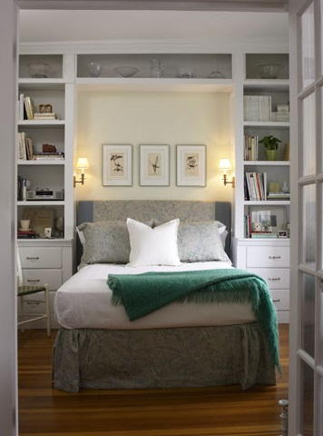 Built in shelves can add a lovely architectural element and ample storage space to a small master bedroom (by Jeanne Finnerty Interior Design)