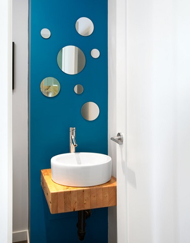 A collection of smaller mirrors can make for a nice statement in a small bathroom or powder room, but might not be the best choice for doing your hair (by Marken Design and Consulting, photo by Ema Peter)