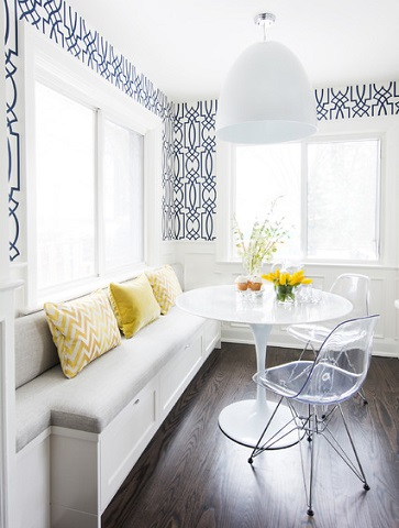 Clear plastic chairs can make a breakfast nook or banquette feel a bit larger and more open while offering added seating (by Ali Budd Interiors, photo by Stephani Buchman )