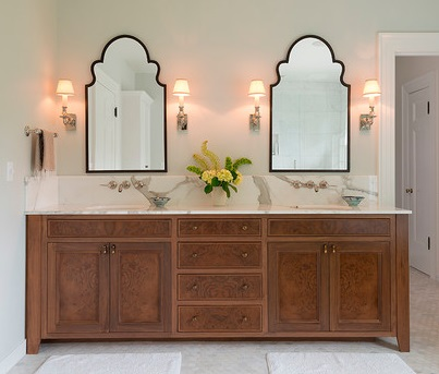 Decorative mirrors with simple yet shapely frames can add a striking architectural quality to a bathroom (by Jenni Leasia Design, photo by Bruce Wolf)