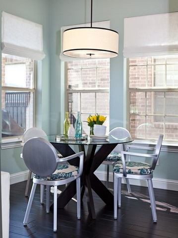 Metal chairs can work surprisingly well in a transitional dining room, particularly if you choose ones with a more traditional silhouette (by Abbe Fenimore Studio Ten 25)