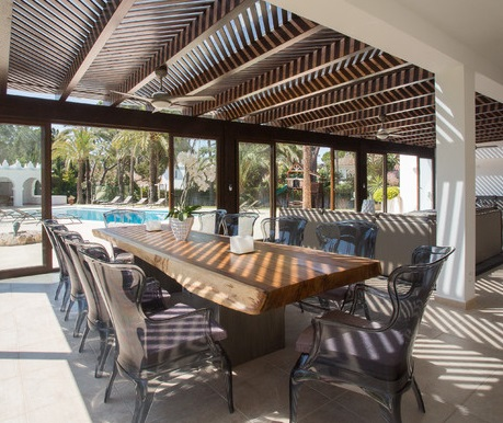 Polycarbonate chairs are sturdy enough to be used outside, but far more stylish than a typical plastic outdoor chair (by Ambience Home Design S.L)