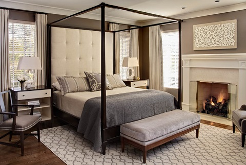 The simple, square lines of this canopy bed lend a contemporary feel to a very traditional furnishing, creating a transitional bedroom that's both elegant and relaxed (Photo by Dustin Peck, design by Design Lines, Ltd, architecture by Dean Marvin Malecha)