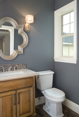 This decorative mirror adds tons of personality to an otherwise fairly simple small bathroom, but it comes at a cost of over-vanity storage (by Alan Mascord Design Associates Inc., photo by Bob Greenspan)