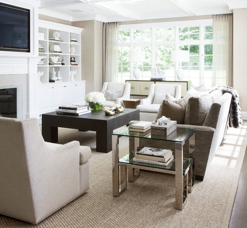 This living room combines simple, square lines with plush furniture and lots of natural, neutral fabrics for a perfect transitional feel (by Tiffany Eastman Interiors, LLC, photo by Hulya Kolabas)